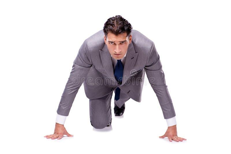 O homem de negócios no começo pronto para correr isolado no branco fotos de stock royalty free