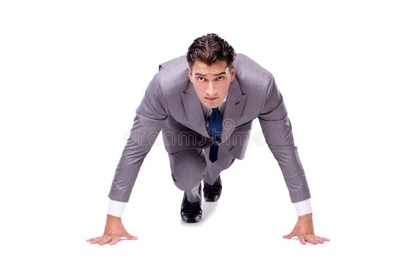 O homem de negócios no começo pronto para correr isolado no branco fotografia de stock