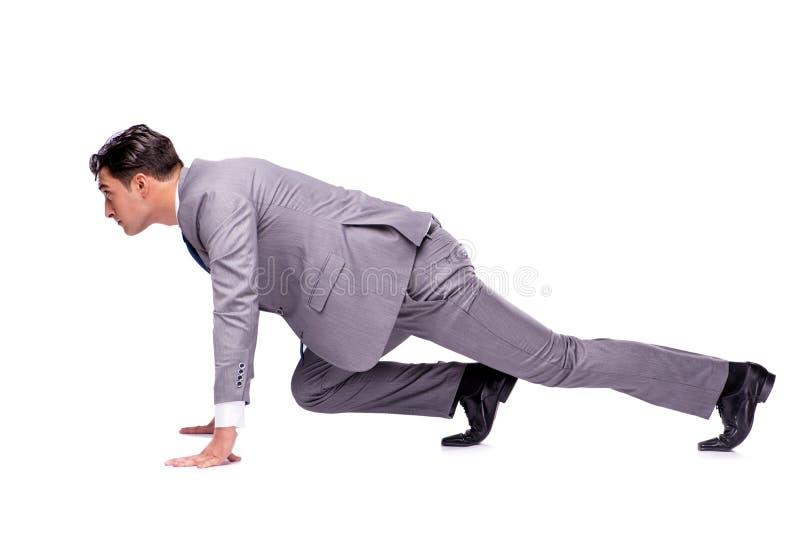 O homem de negócios no começo pronto para correr isolado no branco fotos de stock