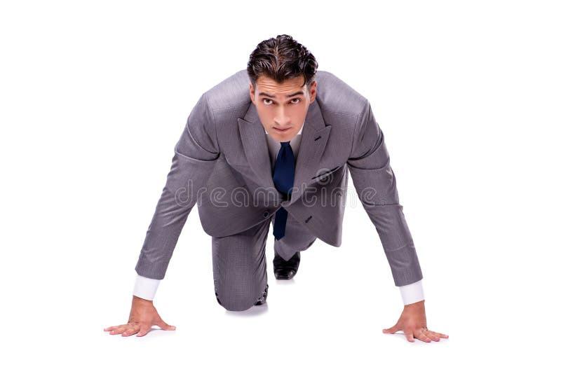 O homem de negócios no começo pronto para correr isolado no branco foto de stock