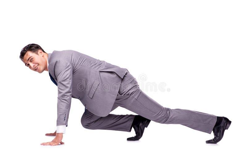 O homem de negócios no começo pronto para correr isolado no branco imagem de stock royalty free