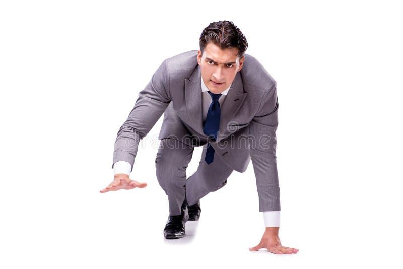 O homem de negócios no começo pronto para correr isolado no branco fotografia de stock royalty free