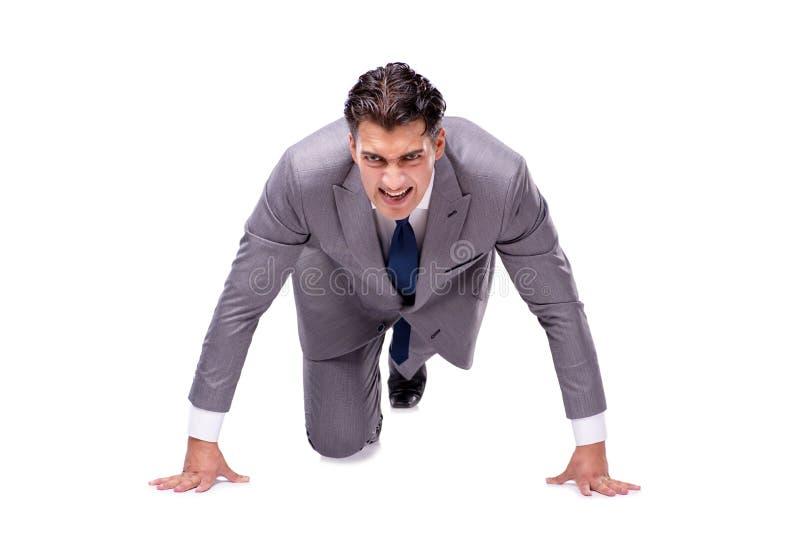 O homem de negócios no começo pronto para correr isolado no branco imagens de stock royalty free