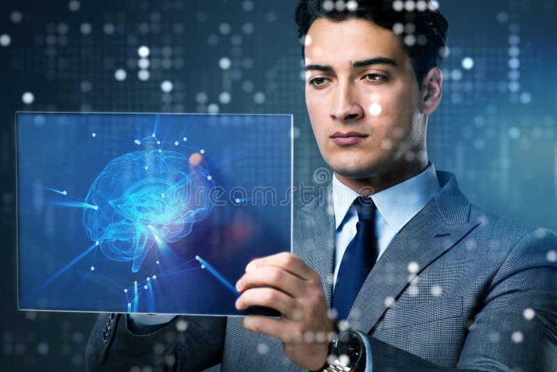 O homem de negócios no conceito da inteligência artificial fotos de stock