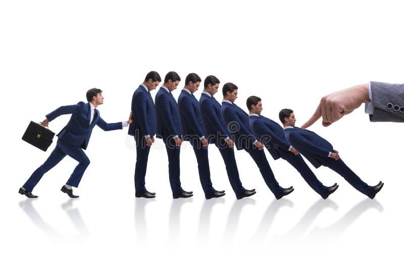 O homem de negócios no conceito do negócio do efeito de dominó fotos de stock royalty free