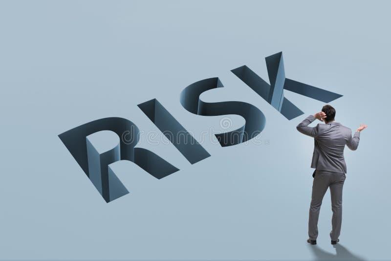 O homem de negócios no conceito do negócio do risco financeiro fotografia de stock royalty free
