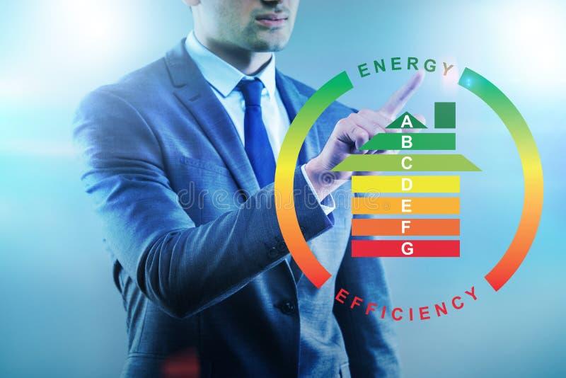 O homem de negócios no conceito do uso eficaz da energia imagem de stock royalty free