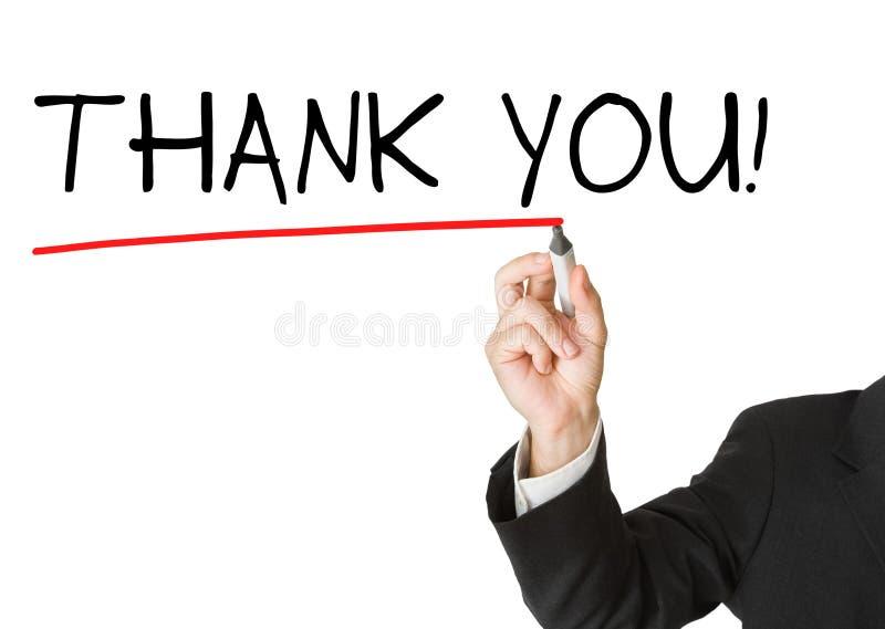 O homem de negócios no terno que tira a palavra 'agradece-lhe' fotografia de stock