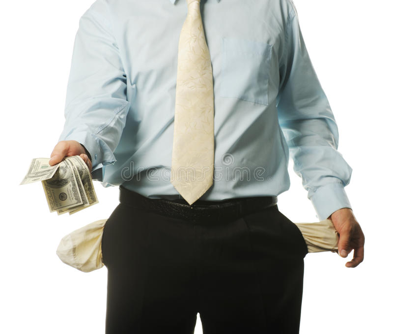 O homem de negócios novo com bolsos vazios imagens de stock