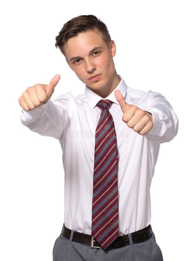 O homem de negócios novo considerável mostra que os polegares gesticulam no branco imagens de stock