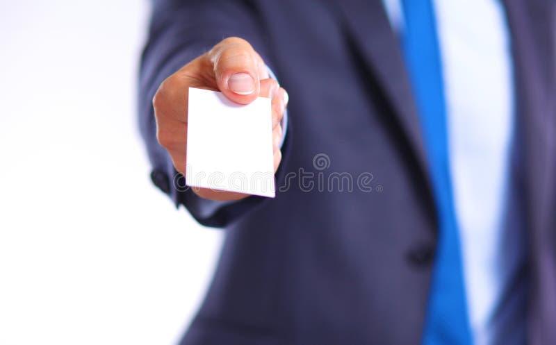 O homem de negócios novo guarda para fora sua mão com um cartão para o amor fotografia de stock royalty free