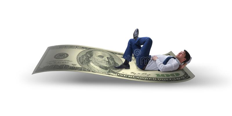 O homem de negócios novo que dorme no dólar isolado no branco imagem de stock royalty free