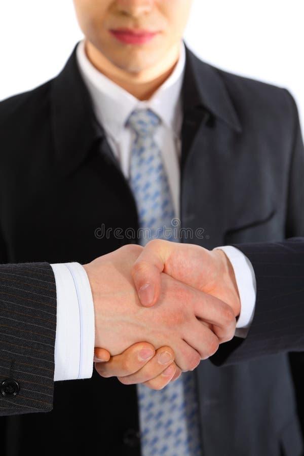 O homem de negócios observa o aperto de mão fotografia de stock royalty free