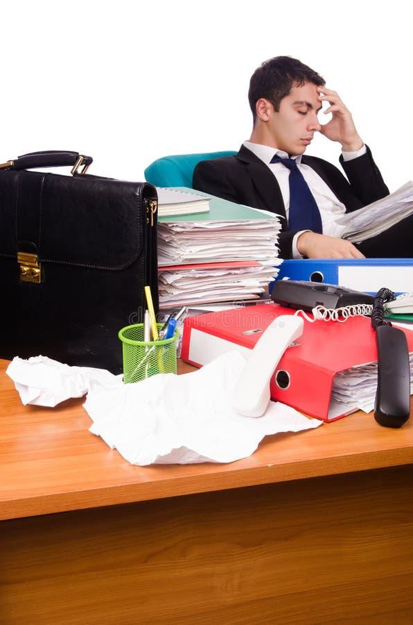 O homem de negócios ocupado sob o esforço de trabalho imagem de stock royalty free