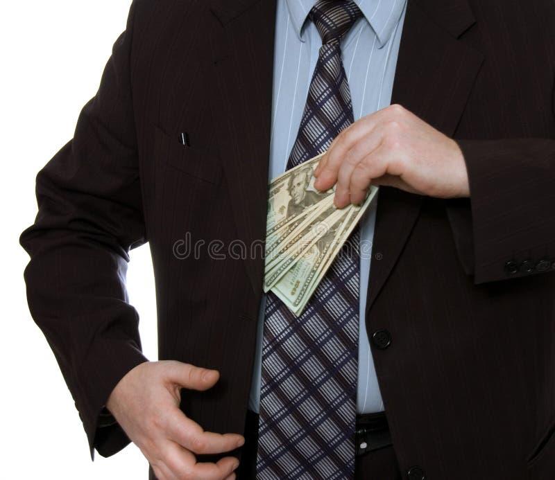 O homem de negócios põr o dinheiro no poc fotografia de stock royalty free