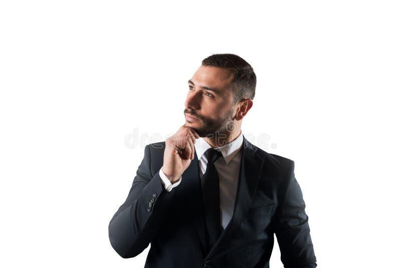 O homem de negócios pensa estratégias novas para crescer acima a empresa Isolado no fundo branco imagens de stock