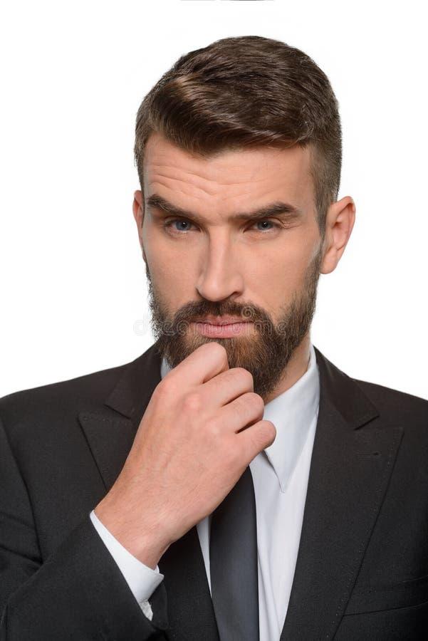 O homem de negócios pensa sobre o negócio imagem de stock