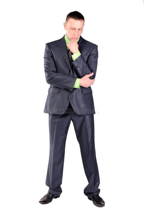 O homem de negócios pensativo é pensar isolado fotografia de stock royalty free