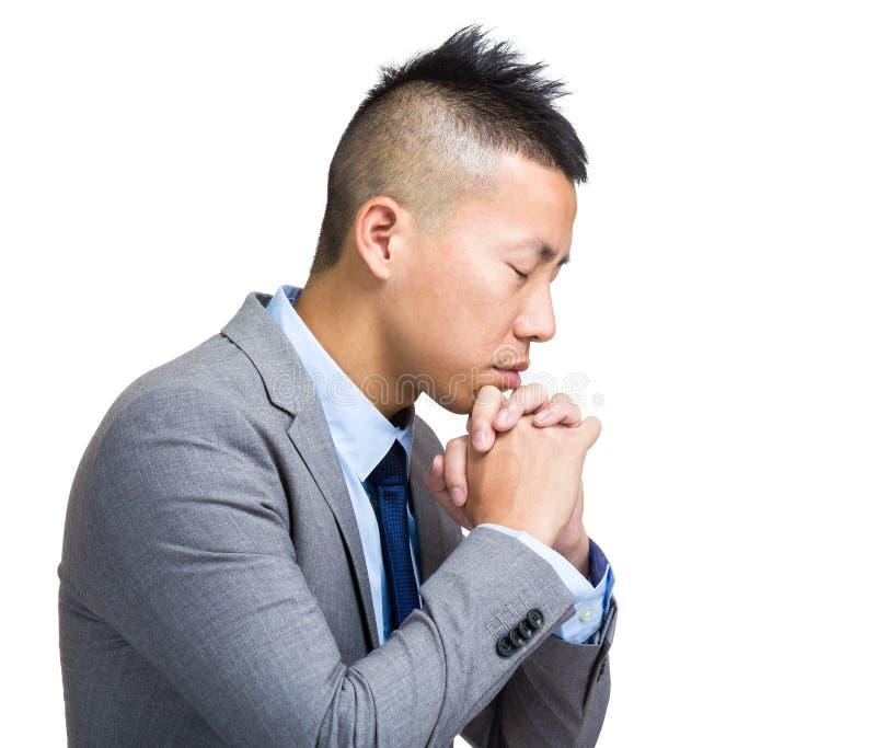 O homem de negócios pray imagens de stock