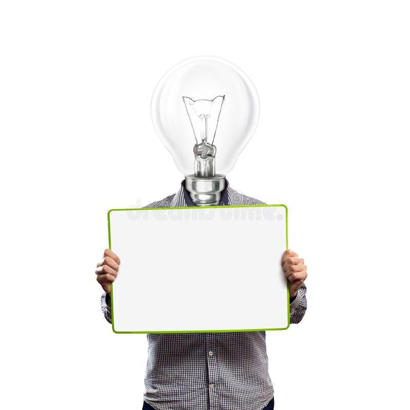 O homem de negócios principal da lâmpada com vazio escreve a placa fotos de stock