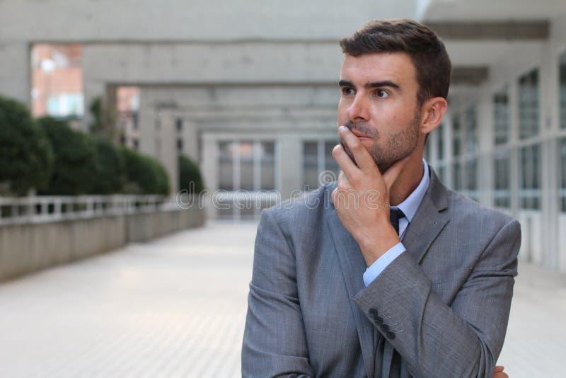 O homem de negócios profundamente nos pensamentos fecha-se acima foto de stock royalty free