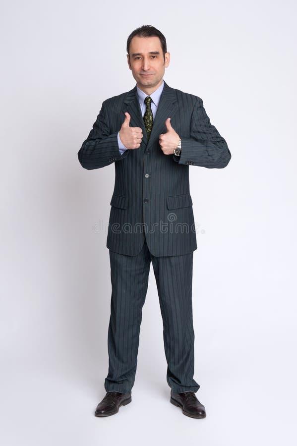 O homem de negócios que faz os polegares levanta o gesto foto de stock