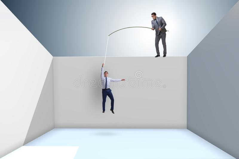 O homem de negócios que pesca seu colega no conceito do negócio ilustração royalty free