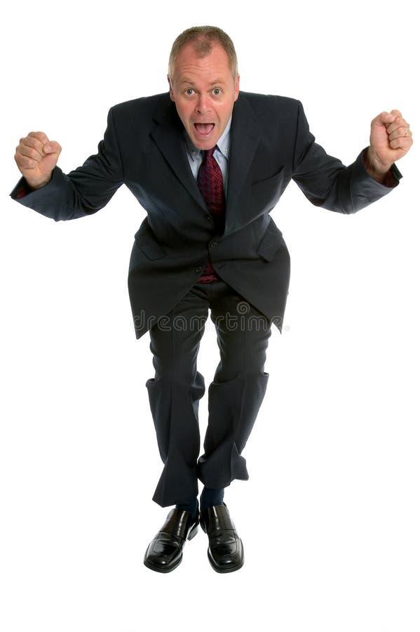 O homem de negócios que salta para a alegria. imagens de stock royalty free