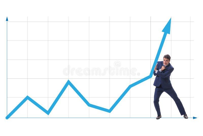 O homem de negócios que tenta ajudar o crescimento econômico no conceito do negócio fotografia de stock royalty free
