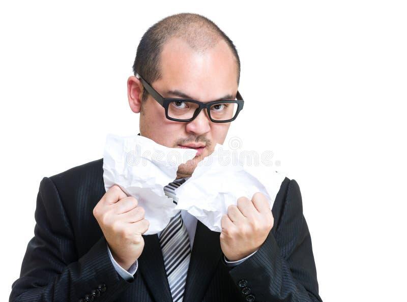 O homem de negócios rasga fora o papel fotografia de stock royalty free