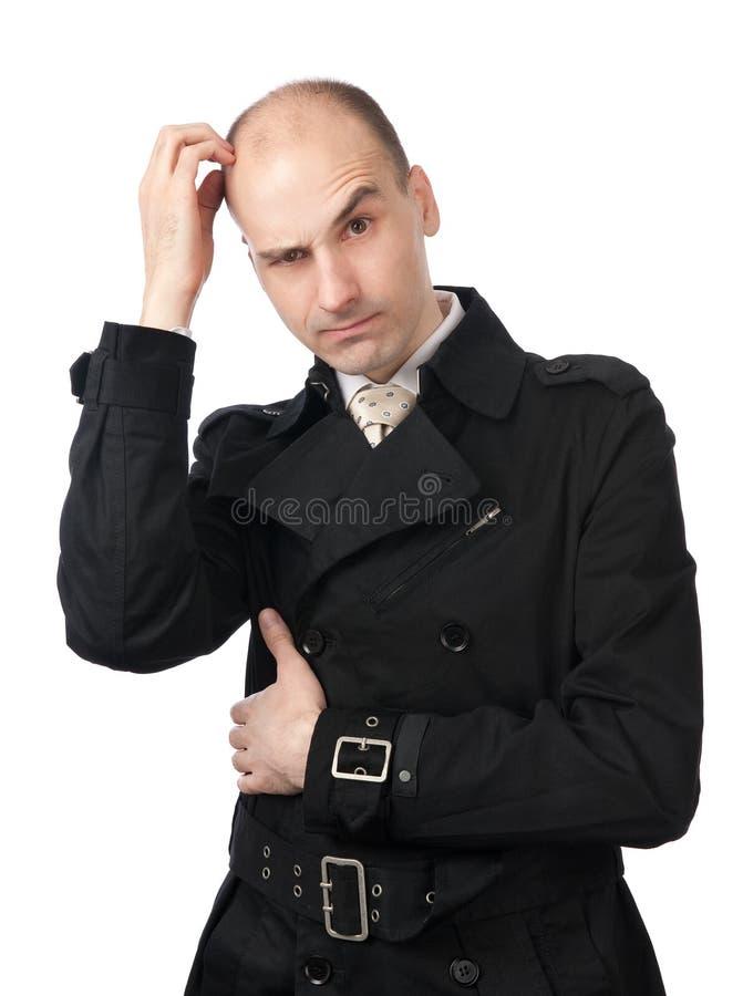 O homem de negócios risca sua cabeça na confusão fotografia de stock