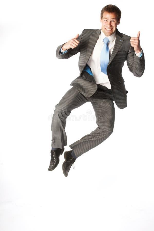 O homem de negócios salta fotografia de stock royalty free