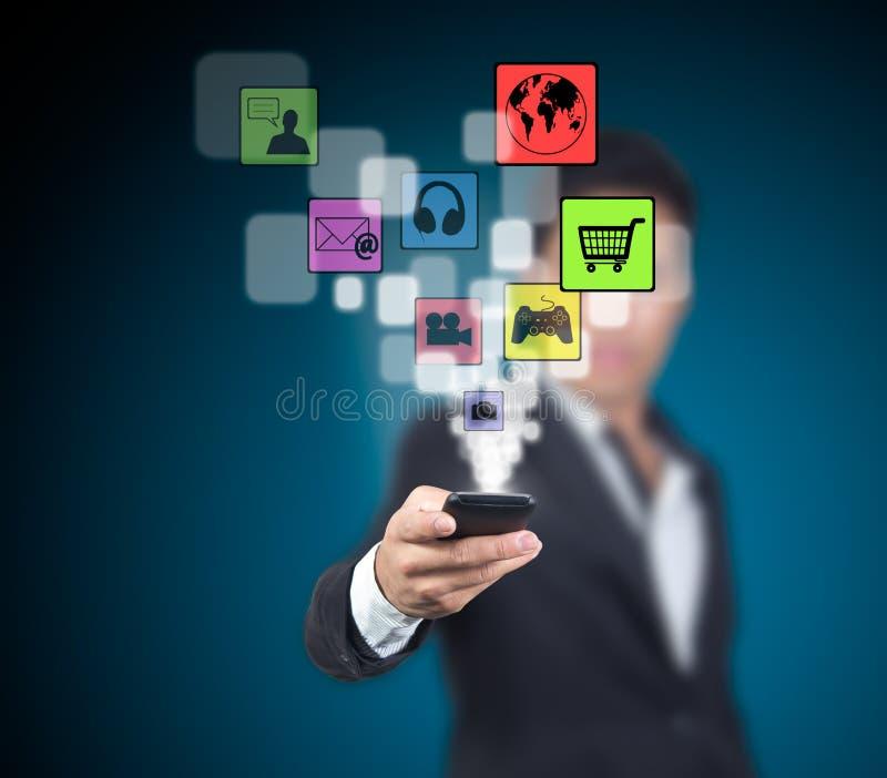 O homem de negócios seleciona a aplicação. imagem de stock
