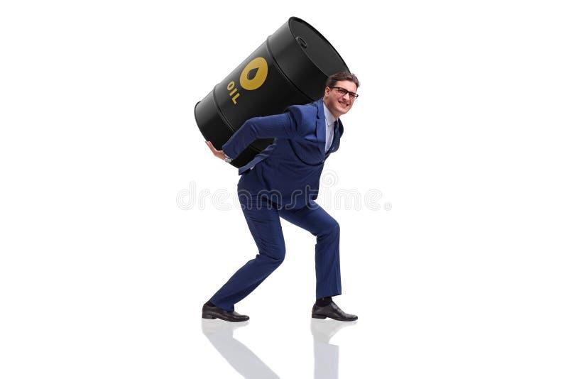 O homem de negócios sob a carga do tambor de óleo no branco imagem de stock royalty free