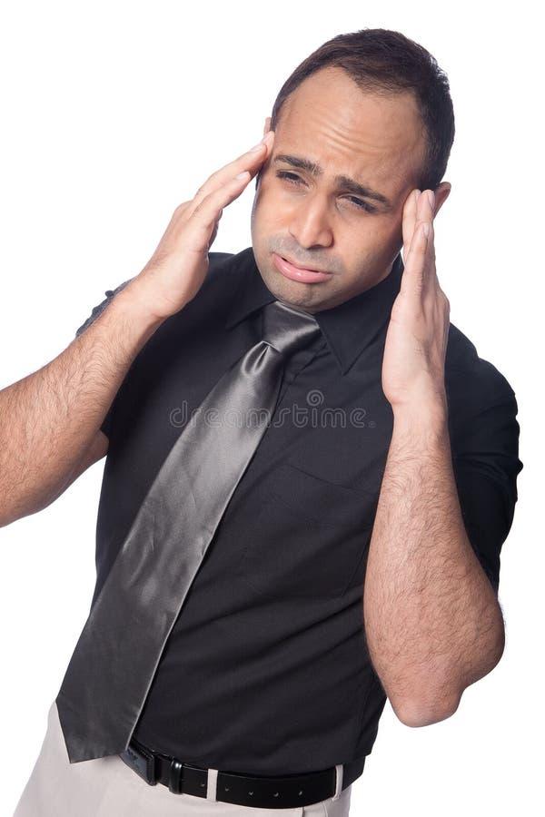 o homem de negócios sofre a dor de cabeça do esforço. fotografia de stock royalty free