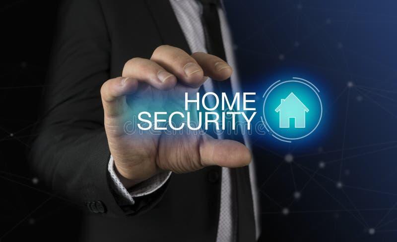O homem de negócios toma um ícone da casa da mão com conceito da segurança interna da inscrição imagens de stock royalty free