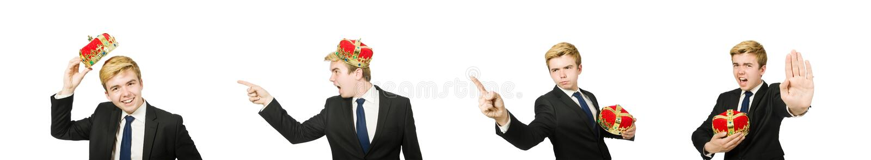 O homem de neg?cios com a coroa isolada no branco imagens de stock