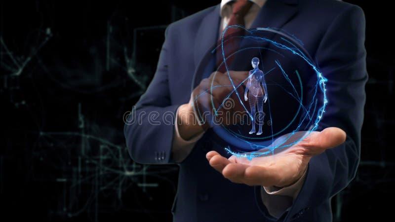O homem de neg?cios mostra a mulher do holograma 3d do conceito em sua m?o fotos de stock