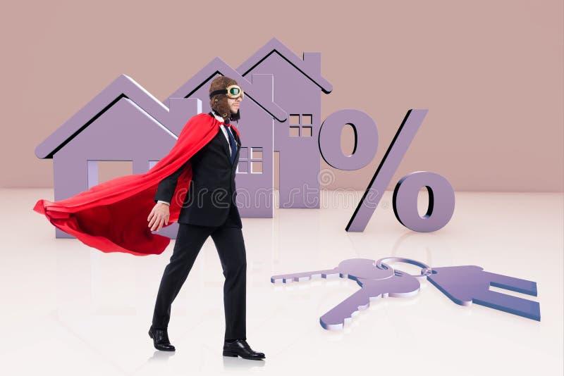O homem do super-herói no conceito da hipoteca fotografia de stock royalty free