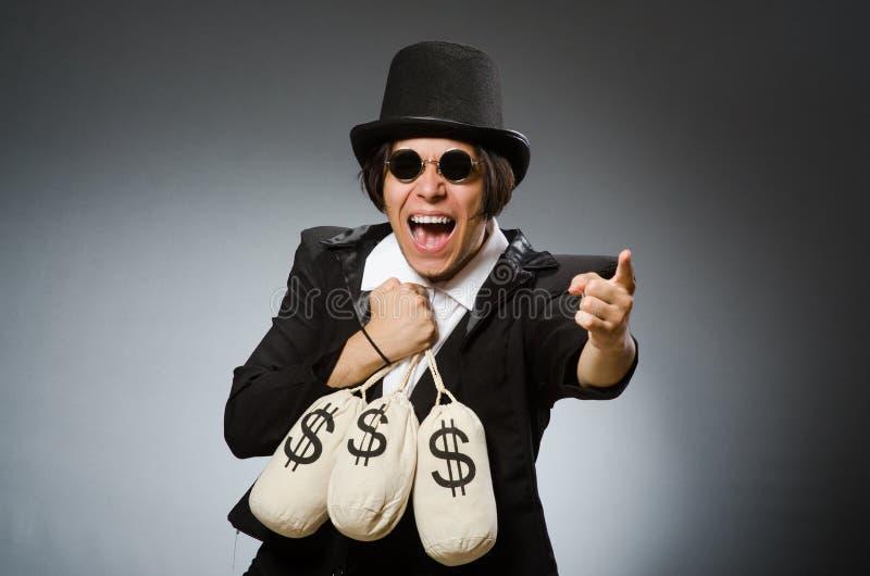O homem engraçado com sacos do dólar fotografia de stock royalty free