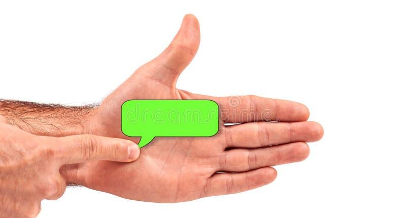 O homem envia sms com sua palma aberta foto de stock royalty free