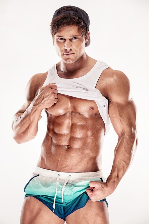 O homem muscular 'sexy' da aptidão que mostra o sixpack muscles sem gordura fotografia de stock