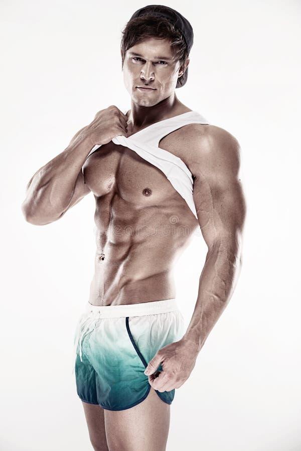 O homem muscular 'sexy' da aptidão que mostra o sixpack muscles sem gordura fotos de stock