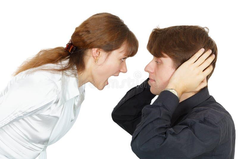 O homem não quer escutar gritos das mulheres fotografia de stock royalty free