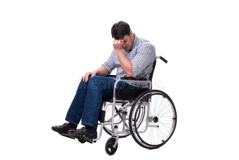 O homem na cadeira de rodas isolada no fundo branco fotos de stock royalty free