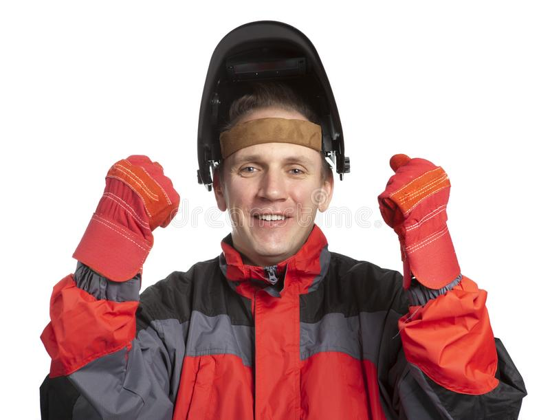 O homem na roupa de funcionamento e em uma máscara do soldador jogou acima as mãos no gesto vitorioso imagens de stock royalty free