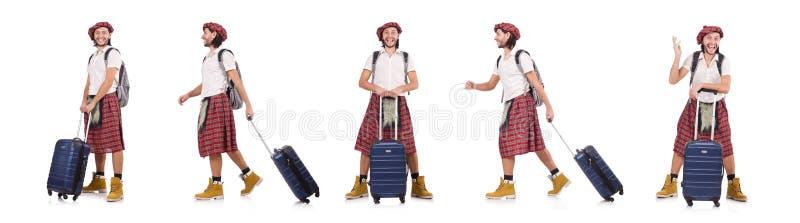 O homem na saia do scottish com a mala de viagem isolada no branco fotografia de stock royalty free