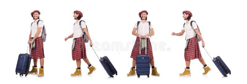O homem na saia do scottish com a mala de viagem isolada no branco imagem de stock royalty free
