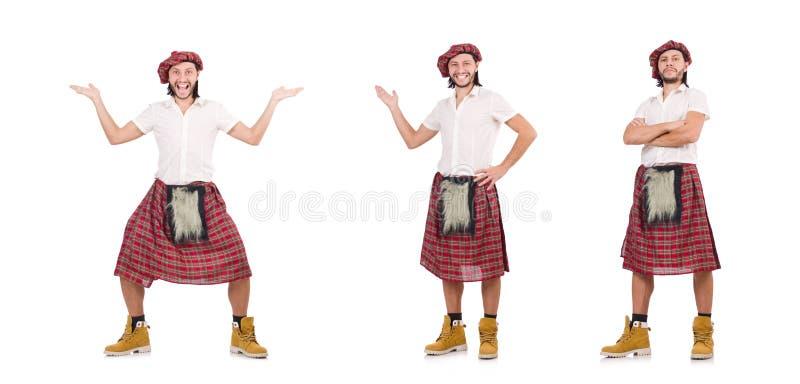 O homem na saia do scottish isolada no branco imagem de stock royalty free