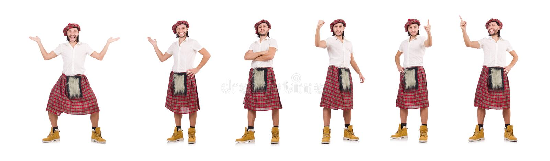 O homem na saia do scottish isolada no branco foto de stock royalty free